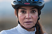 'A Woman In A Bicycle Helmet Dripping With Sweat; Tarifa, Cadiz, Andalusia, Spain'