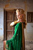 'A Woman With Long Blond Hair Wearing A Sari; Ludhiana, Punjab, India'