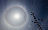 'A Sailboat Mast Is In The Foreground Of A Sun Dog; Vancouver Island, British Columbia, Canada'