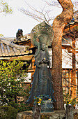 'Japanese temple statue in morning light;Kyoto japan'