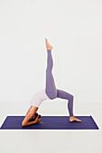 'A woman in a yoga pose;Tarifa cadiz andalusia spain'