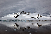 'A mountain reflected in the tranquil southern ocean;Antarctica'