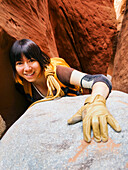 'A female athlete exploring utah slot canyons;Hanksville utah united states of america'