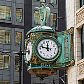 'Clock mounted on the side of a building;Chicago illinois united states of america'