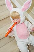 'Baby girl dressed in rabbit costume;Millet alberta canada'