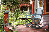 'Two Chairs On A Deck In A Backyard Surrounded By Plants; Winnipeg Manitoba Canada'