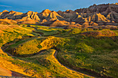 'The area called yellow mounds lit by the sunset in badlands national park; south dakota united states of america'