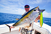 'Man holding just caught yellowfin; panama'