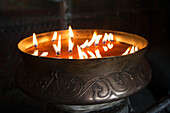 'Flames burning in a bronze container at the jokhang temple;Lhasa xizang china'