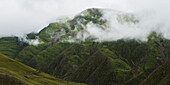 'A rugged mountain top under the clouds;Xizang china'