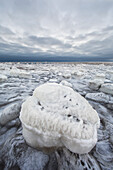 'Ice covered rock along the shores of hudson's bay outside churchill;Manitoba canada'