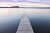 'A dock in lake superior at sunset;Thunder bay, ontario, canada'