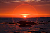 'Sunset over mannin bay in a circular glare;County galway, ireland'