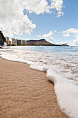 'View of waves coming onto the shore of waikiki beach with diamond head in the distance;Waikiki oahu hawaii united states of america'