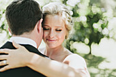 'A bride and groom in an embrace;Pemberton british columbia united states of america'