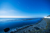 'Seascape of the pacific ocean with star trails in the sky;Big sur california united states of america'