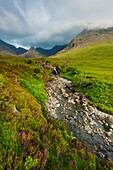 'Waterfall in Coire na Creiche (The Fairy Pools) near Glen Brittle with the hills of the Black Cuillin in the distance; Isle of Skye, Scotland'