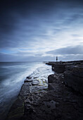 'Scenic Ireland, with a dramatic view of Inis Oirr lighthouse and coastline; Aran Islands, Ireland'