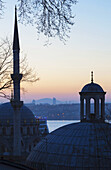 'Sunset over Istanbul with an islamic mosque in the foreground; Istanbul, Turkey'