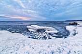 'Cool blue ice and clouds on softer ice on the shores of Lake Michigan; Wisconsin, United States of America'