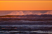 'Wind across crest of waves at sunset, Golden Gate National Recreation Area; San Francisco, California, United States of America'