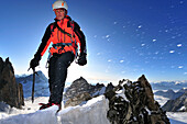 Mountaineer on the ridge of Tour Ronde, Mont Maudit, Mont Blanc Group, France
