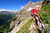 Kid walking on the Pflerscher Höhenweg, Pflerschtal, South Tirol, Italy