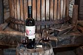 Bottle of red wine and two glasses on a cask, Korcula, Dubrovnik-Neretva, Croatia