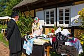 People in traditional costumes in Open Air Museum Lehde, Spreewald, UNESCO biosphere reserve, Lübbenau, Brandenburg, Germany, Europe