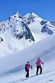 Two female back-country skiers ascending to Eiskoegele, Obergurgl, Oetztal Alps, Tyrol, Austria