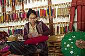 Woman working on a handmade Umbrella, Pindaya, Shan State, Myanmar, Burma