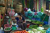 Woman at a vegetable street stall, market at Yangon, Rangoon, capital of Myanmar, Burma