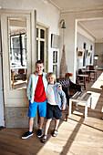 Boys in Restaurante Villa Teresita, Hostal Spa Empuries, Platja del Portitxol, Girona, Costa Brava, Spain