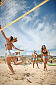 Women playing beach volleyball near the Water Sports Centre, Martinhal Beach, Sagres, Algarve, Portugal, southernmost region of mainland Europe