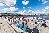 People sitting at Jungfernstieg terrace, Hamburg, Germany