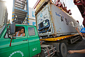 Loading of a container on a truck at harbor, Port of Tianjin, Tianjin, China