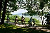 Cycling at Rosen island near Feldafing, west bank of Lake Starnberg, Bavaria, Germany