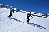 Two back-country skiers downhill skiing from Piz Lagrev, Oberhalbstein Alps, Engadin, Canton of Graubuenden, Switzerland