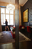 Woman in room no. 08, hall and room designed by Matteo Thun, Altstadt Vienna Hotel, Kirchengasse 41, 7th district, Vienna, Austria
