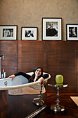 Woman in the bathtub beneath original photographs, Bel Etage Suite room no. 220, Das Stue Hotel, Drakestrasse 1, Tiergarten, Berlin, Germany