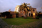 Exterior of La Reserva Rotana Finca Hotel Rural with palm tree and rainbow, near Manacor, Mallorca, Balearic Islands, Spain, Europe