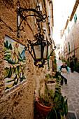 Lamp and Santa Catalina tile on house in alley, Valldemossa, Mallorca, Balearic Islands, Spain, Europe