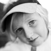 Blond boy with a cap looking into camera (black and white photo using Lensbaby technique), Borden, Western Australia, Australia