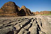Dry river bed in front of the Bungle Bungle range, Purnululu National Park, Western Australia, Australia