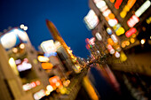 City lights along a canal with bright neon advertising in soft focus (image using Lensbaby technique), Osaka, Kansai Region, Japan