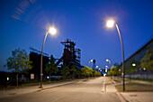 Old industrial buildings of the Hoerder Bergwerks- und Huetten Verein at dusk with street lamps (image using tilt-shift soft focus technique), Hoerde, near Dortmund, North Rhine-Westphalia, Germany, Europe