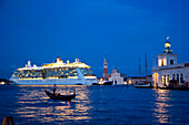 Silhouette of a gondola in front of cruise ship Serenade of the Seas (Royal Caribbean International) passing Isola di San Giorgo Maggiore island at dusk, Venice, Veneto, Italy, Europe