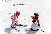 Girl and snowman with skies, Kreischberg, Murau, Styria, Austria