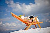 Snowman in a deckchair, Styria, Austria