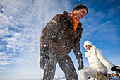Laughing couple in snow, Muehlen, Styria, Austria
